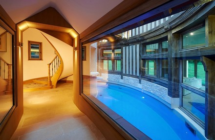 The 6,000-square-foot, two-story round house is built around a central swimming pool